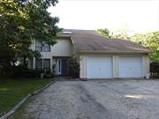 Investment opportunity. 4 bedroom, 3 bathroom spacious contemporary with pool on 1.3 acres. Needs work.