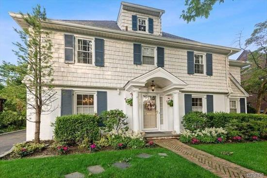 A traditional center hall colonial in the heart of the Estates section, short distance to multiple LIRR lines - Commuters' delight. First floor features formal DR and and LR with den/office. Master suite on the 2nd floor with over sized WIC. Ample storage spaces throughout the house. Third floor has a BR with full Bath. Close to all. A true ready-to-move in home with brand new roof.