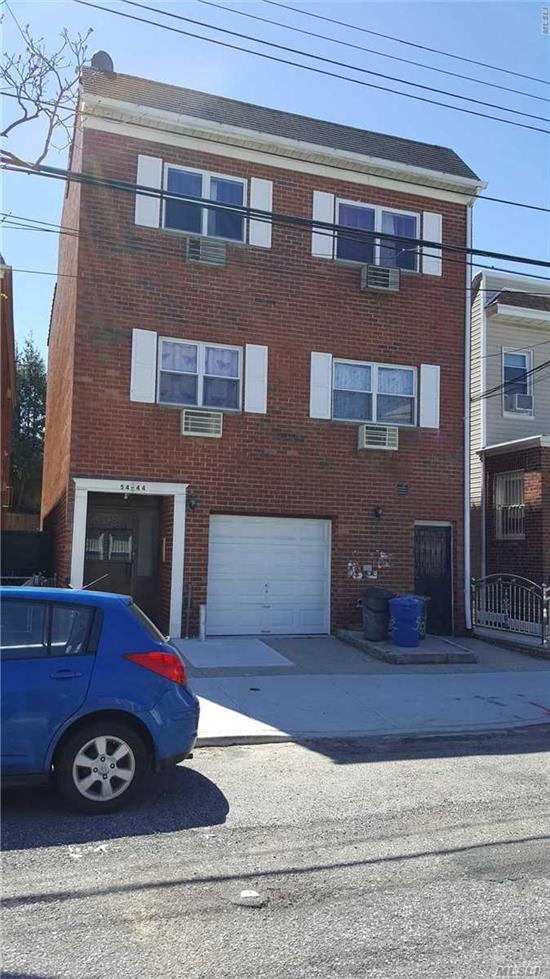 Excellent investment property completely detach brick building first floor office Plus 4 Apartments garage private backyard walking distance to shopping and transportation