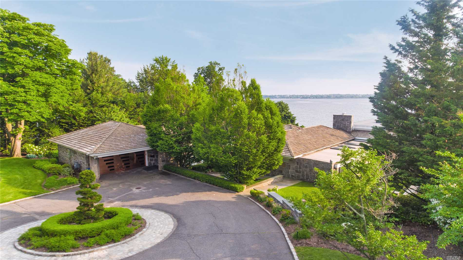 1.25 Waterfront Acre Retreat! This Gorgeous Modern Ranch is located in the prestigious Village of Kings Point. An entertainer's Dream with Panoramic West Side waterviews of the Manhattan Skyline & City Bridges. An Oasis built by renowned architect. Spectacular sunsets, luscious green lawns and specimen plantings. This Gem features a Master Suite, 3 Additional Bedrooms, 4 Full Baths and 2 Half Baths, Lovely Eat-in-Kitchen, Spacious Living room with fireplace, Full Generator, Pool & so much more.