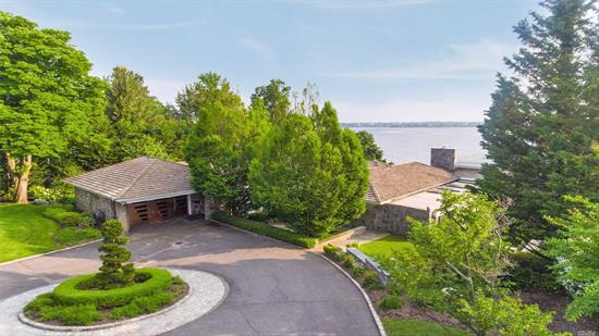 1.25 Waterfront Acre Retreat! This Gorgeous Modern Ranch is located in The prestigious Village of Kings Point. An entertainer's Dream with Panoramic West Side water views of the Manhattan Skyline & City Bridges. An Oasis built by renowned architect. Spectacular sunsets, luscious green lawns and specimen plantings. This Gem features a Master Suite, 3 Additional Bedrooms, 4 Full Baths and 2 Half Baths, Lovely Eat-in-Kitchen, Spacious Living room with fireplace, Full Generator, Pool & so much more