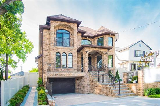 Newly Built 1-Family House Features On 1st Floor:Living Room, Formal Dining Room, Kitchen, Family Room, 1 Bedroom, Full Bathroom, S.O.E. To Backyard, Porch w/B--B-Q Grill. On 2nd Floor:2 Master Suite, 2 Reg. Bedrooms, 3 Bathrooms (1 w/Jacuzzi). In Basement:Open Space, Full Bathroom, Laundry Room, Boiler Room, Garage, S.O.E. To Backyard. Floor Heating (12 Zones) On 1st & 2nd Floor, C A C (5 Zones). Close To Q15, Q15A, Q.M.2. P.S. 193. Mall & Bank In Whitestone.