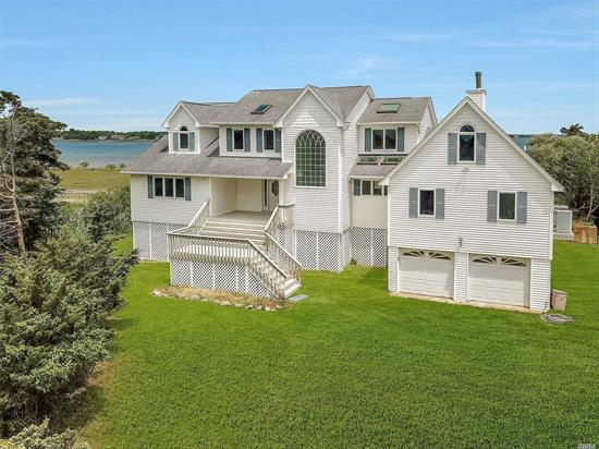 Bayfront Paradise! This luxurious custom built home in 1996 is masterfully designed w/luxury in mind. Spanning 3500SF, this magnificent residence graced by soaring ceilings & wall to wall windows is a haven for panoramic bay front views. The grand entryway w/open living room, Eik, & Dining Area w/magnificent views and windows all around, First floor has master ste w/bth & walk in closet, 2nd floor master ste w/bth & walk in closet on 2, 7 cesspools, dock, & private bay w/magnificent views!