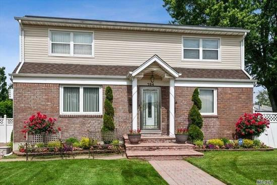 4 bedrooms, 2 baths, brick wide line cape, full front & back dormer, beautiful kitchen w/sliders looking onto a fabulous back yard, paved driveway and back yard,  School District #13, Valley Stream School. Stunning, Come & See!