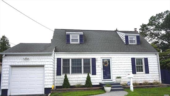 Beautifully maintained and recently updated four bedroom two bath cape featuring a new bathroom, pocket doors, flooring, and fresh paint throughout. The kitchen features new countertops and the dining area is an open floorplan that makes entertaining easy. A must see!