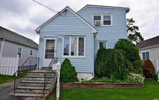 Fully Updated Expanded Cape, Renovated in 2017. 4/5 Bedrooms, New Kitchen W/ Granite And Stainless Steel. Hardwood Floors Throughout. Roof Replaced 2017, Possible Mother/Daughter With Proper Permits.
