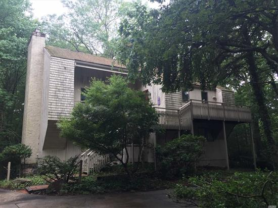 Interesting three story Contemporary situated on 2.3 very private acres bordering parkland. Dramatic cathedral ceiling Great Room with stone fireplace, Guest quarters Close to harbor and shops. Needs work but has definite showplace potential