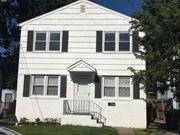 Completely Renovated Second Floor 2 Bedroom Apartment. Shared Backyard.