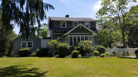 Traditional 1930s Vintage Cape approx 1544 Sq.Ft. Hardwood Floors throughout. Open Main Level Floor Plan with Spectacular Glass Sitting Area and Master Bedroom Suite. Large Multi-Level Entertainer's Deck across the entire rear of the home with out door shower. Rear Tennis Court with detached 14'x18' Tennis Cabana situated on a wide .59 Acre parcel that goes all the way through to Pine Street. Move-in adorable. Will consider selling furnished - select artwork / pieces excluded.