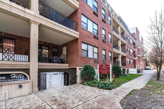 Bright large 2 bedroom, 2 bath apartment on quite street. Unit features a beautiful fully equipped modern kitchen with Stainless Steel appliances & granite counter-tops. Large living-room w/huge balcony. The unit comes with washer/dryer for your convenience. 1 bedroom, bath & Master w/full bath. The unit comes with 1 parking spot. Close to supermarket, post office, I-495, buses Q64, Q65, QM4 & QM44.