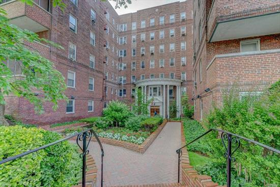 Move in ready top floor jr4/2 bedrooms with a private sun drenched balcony. Extra large unit fully renovated features ss appliances, granite counters, cork flooring in kitchen and amazing hard wood throughout. Located in the heart of Kew Gardens, few blocks to subway and LIRR, shopping and Forest Park with over 500 acres of fun - bike trails, jogging trails, horse back riding and more. Building is immaculately kept; doorman, laundry on site, parking, and bike and storage. Won't Last!!
