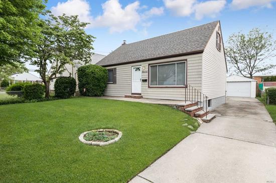 Well maintained 4 bedroom, 2 full bath Cape with kitchen, living room, dining room and a beautiful backyard with inground sprinklers and 1.5 car detached garage. Close to LIRR, only 30 minute train to NYC. Mall nearby.