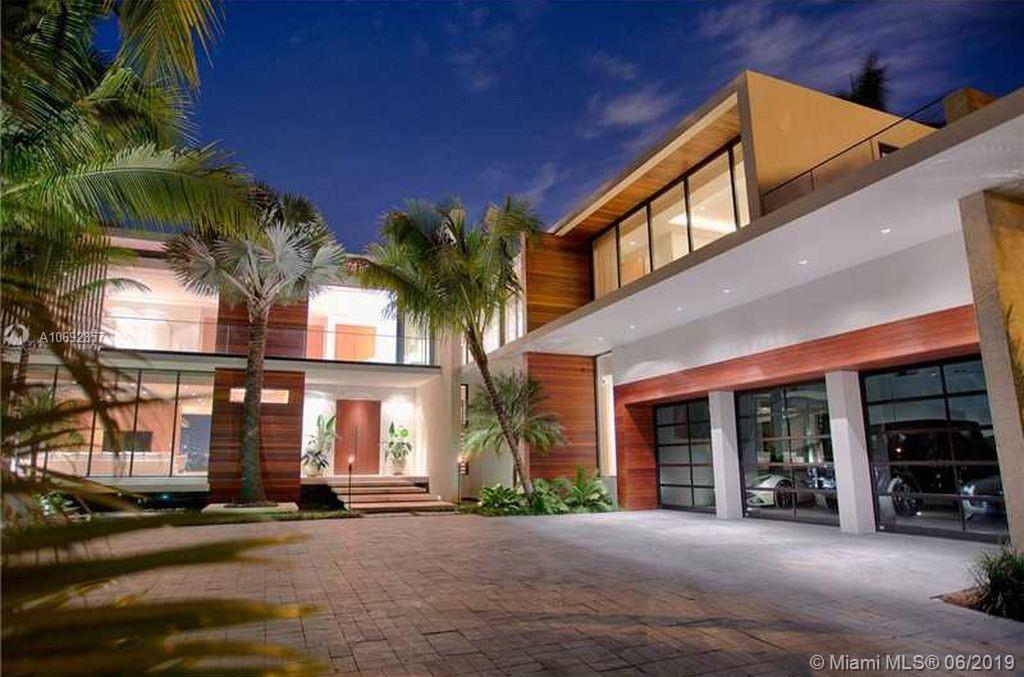 Magnificent Modern Waterfront Estate Located On Prestigious Guard-Gated Hibiscus Island. Impeccably Designed By Renowned Architect Ralph Choeff. Situated On A 19, 466 Sf Pie Shaped Lot Boasting 10, 503 Sf Of Living Space Plus 145 Wf With Unobstructed Southwest Facing Stunning Downtown & Cruise Ship Views. Luxurious Amenities Include: Chef'S Kitchen, Butler'S Pantry, Wet Bar, Home Theater, Wine Cellar, Elevator, 3 Car Garage, Lap Pool W/ Jacuzzi Plus Outdoor Shower, Summer Kitchen, Beach Area W/ Firepit, 3 Car Garage, New Seawall & Private Dock + Secluded Rooftop W/ Kitchen, Jacuzzi & Outdoor Shower.