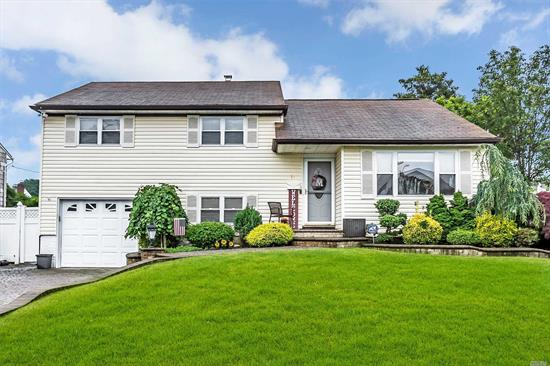 Beautiful Split Level Home in the Desirable North Massapequa Plainedge School District. 4 Bedrooms, 1.5 Bathrooms, Eat In Kitchen w/ Stainless Steel Appliances, Formal Dining Room, Formal Living Room, Large Den, Attached Garage, Nicely fenced in backyard.Lovely Curb appeal, low taxes, GAS COOKING AND DRYER. MOVE IN READY!