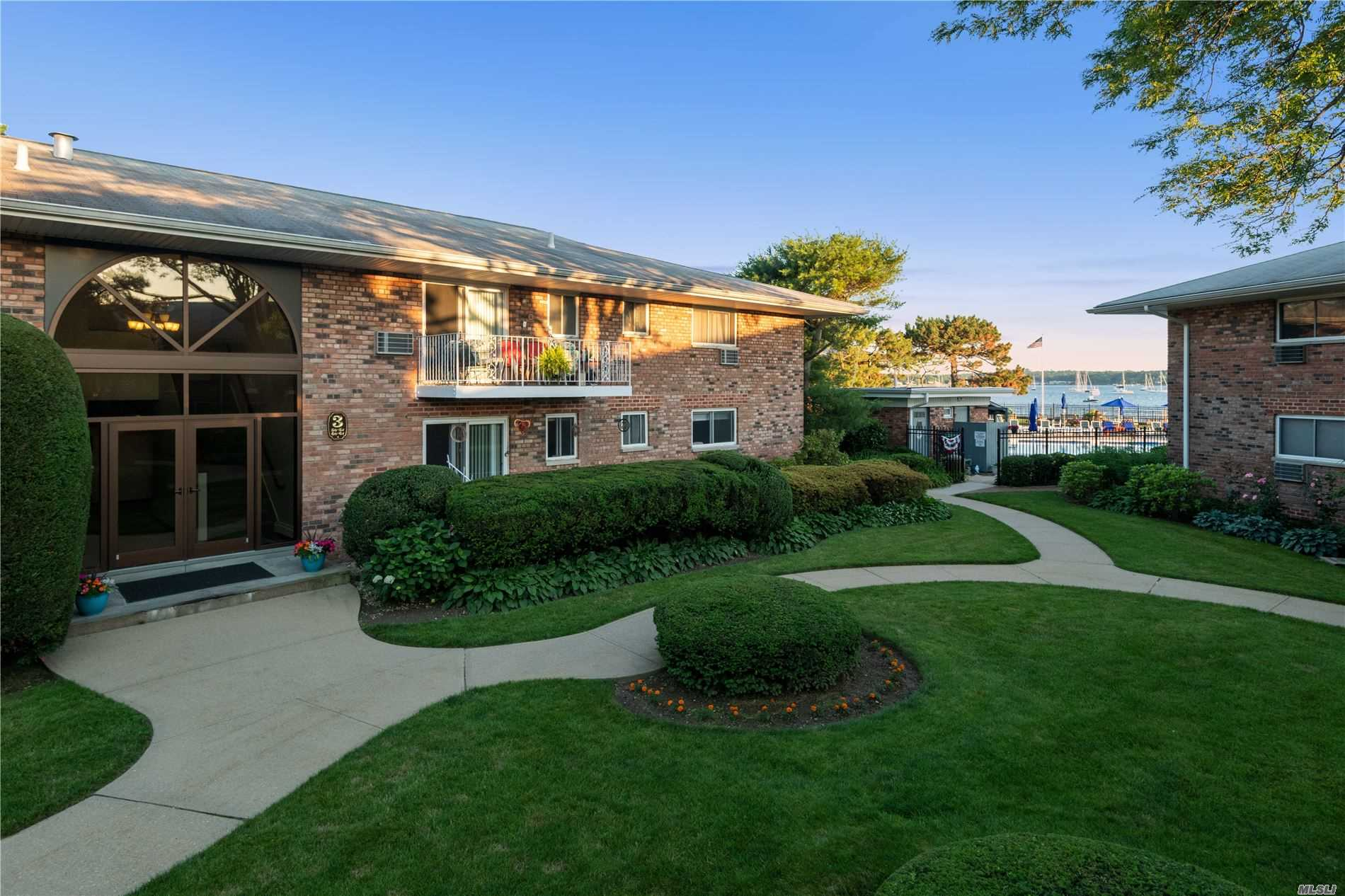 Ideal 2nd Floor Apt w/ 2 Bdrm, 2 Bath and Views of Pool and Manhasset Bay from Bedroom and Balcony, Updated kitchen and baths, Closets Galore, Hardwood Floors, Laundry, Storage, Outdoor Pool, Manicured Grounds, F/T Super on Premises