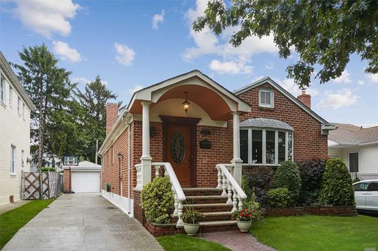 Pristine brick ranch on a tree lined street.featuring 3brs, 3 baths, spacious open concept; living room, dining room, EIK. energy efficient appliances.wood floors throughout, a True Must See!!!