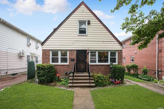 Location! Location! Location! Expanded cape close to public transportation and shopping. Long private driveway. Two family with Living Room, Bedroom, Kitchen and Bath on second floor with side entrance. Two Bedrooms on the first floor with hardwood underneath the carpet.  Nice size backyard with covered patio for entertaining. Zoning is R3-2