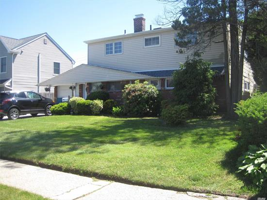 If you are looking for a spacious colonial or mother/daughter (need to file proper permits with Town of Hempstead) boasting 12 rooms and true park like grounds...this is it! Two year old double driveway and garage door leads to back to back 2 car garage. The roof is 4 years old. First floor offers an additional den while upstairs offers a deck overlooking the beautiful grounds. You will enjoy the benefits of the towns and schools.
