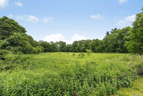 2.28 Acre level lot on prestigious street in Old Brookville. Build up to a 6, 000 square foot home with accessory structures. See attached survey and covenants and restrictions.