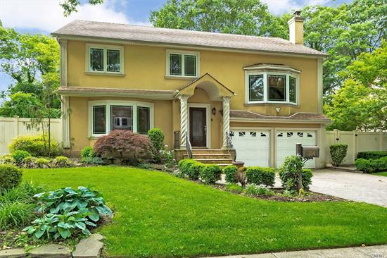 Westbury, Welcome To This Gorgeous Gut Renovated 4 BR Home Offering A Fabulous Open Floor Plan Built to Perfection W/ Custom Carpentry & Gleaming Hardwood Floors, A Gourmet Kitchen Showcasing State-Of The-Art Energy Efficient Appliances, Wolf, Subzero, Miele & A Butler's Pantry W/ Wine Cooler & Wet Bar. Radiant Heat Throughout First Floor, Custom Fitted Closets, Central Vacuum, Tons of Storage/ Closet Space/ Pantries, A Third Floor Attic Space, A Huge & Beautifully Fenced Backyard And Much More!