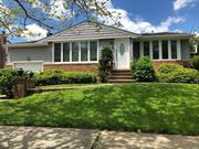 Renovated multi-level split on quiet Cedar Bay Park street with 5 bedrooms, 3.5 bathrooms, and much more.