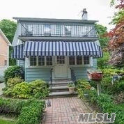 Colonial located on beautiful Flushing North block. Near Bowne Park. Updated kitchen and bathroom. Formal Dining room, living room with fireplace, front sun porch, den, 5 bedrooms, huge back yard, 1 car garage and garden. Walk to Northern Blvd, buses and LIRR. Convenient to major highways and shopping.