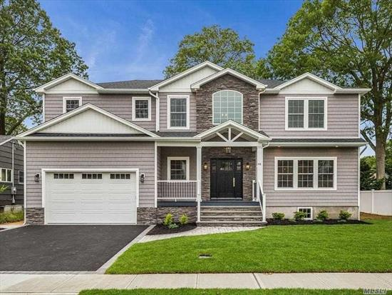 ELITE CUSTOM COLONIAL sits mid-block on wide, tree-lined street in heart of The Village. Expertly-designed NEW home on large prop is totally turn-key complete W/a designer eat-in kitchen well-complemented by under cabs/counter lights, a pot filler above gas SS stove, supersized farm sink, 9' island, & an open-flow into: DiningRm, LivingRm, & FamRm w/coffered ceiling+gas fplc. Add'l Features= Gorg Lscaping+UG Sprnk+Paver Patio+Fin Bsmt+Pella Wdws+Steam Shwr w/BodySprays+WALK to RR/TOWN, +MuchMore!