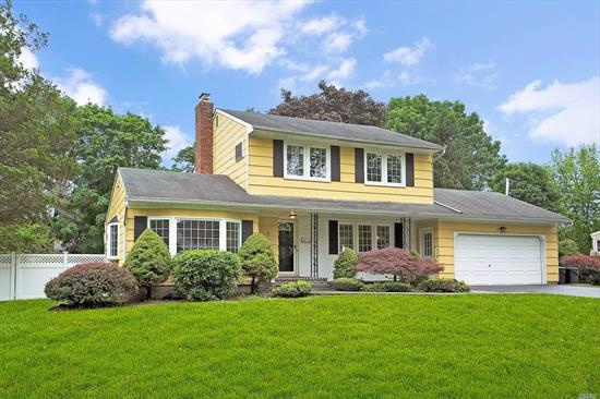 Lovely Colonial on Superior Mid Block Interior Setting in Commack SD#10; Wonderful 1/2 Acre Level, Fenced and Landscaped Property; Refinished Hardwood Throughout, Freshly Painted Including Moldings/Trim, Updated EIK with Stainless Appliances, Family Room with Brick Wall Woodburning Fireplace, Main Level Office/Guest Room, Oversized Drive and Two Car Garage.