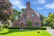 Meticulous and beautifully updated, this 1930's Tudor is Move-In Ready! Timeless Slate Roof and Copper Gutters add style and warmth to the brick exterior! With 3 Bedrooms, 1.5 Baths, this turn-key home has approximately 1700 square feet of living space with modern updated Kitchen and Baths, Fireplace, Hardwood Floors throughout, Anderson Windows, 200-amp electric, gorgeous yard with stone patios and 2.5 Car Detached Garage! Driveway is shared with neighbor. Must See!