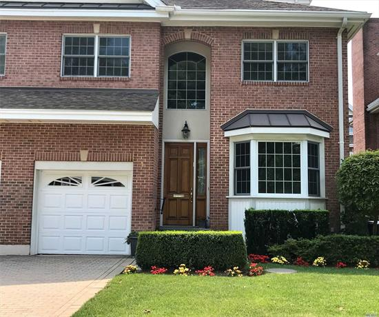 Three Story Townhouse In The Great Community Of Portico. Elegant Foyer Leads To A Formal DR, Living Room With Fireplace, Den & Eat In Kitchen. Indoor Garage With A Drive Way For The Second Car. A Huge Master Suite on Second Floor W/ Balcony & Seating Area, 3 More Bedrooms and A Bath. Third Floor Has A Beautiful Large Loft With Hi Ceiling & A Full Bath. Full Basement W/ Laundry. The Community Offers 24 Hour Gate Security, Gym, Party Room & Playground. Near Lirr Restaurants & Shopping.