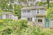 Beautifully Updated 2-Story Home with Lots of Charm! Stone Front, Open Floor Plan with EIK with White Cabinets, Ceramic Tile, Hardwood Floors, Hi Hats, Ceiling Fans, Andersen Windows, Lovely Yard with Flower Gardens, 2 Decks, Patio, 2 Sheds, & More! Only 150' From North Shore Beach! Perfect for Year Round or Summer Getaway! A Must See!