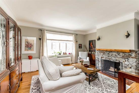 Stunning Spacious 2BR Apartment In This Charming Pre-War Building Featuring 9 Foot Ceilings, Wood Plank Floors, Working Fireplace, Modern EIK w/Stainless Steel Refrigerator, New Designer Bathroom With High Quality Materials And Finishes. Pet Friendly Building. 2 Blocks To LIRR.