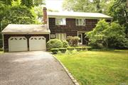 Traditional 4 Bedroom 2.5 bath Center Hall Colonial located North of 25A is the One you have been waiting for! Cozy Den w/Built-ins and Fireplace w/Door to Outside Deck Overlooking Parklike .39 Acre Property. Oversized Formal Living Rm/Dining Room Combination. Hardwood Floors Throughout the Entire Home. Master Bedroom En-Suite with 3 Additional Oversized Bedrooms and Full Bath. 2 Car Attached Garage. Fabulous Location in Three Village Schools. Wont Last!