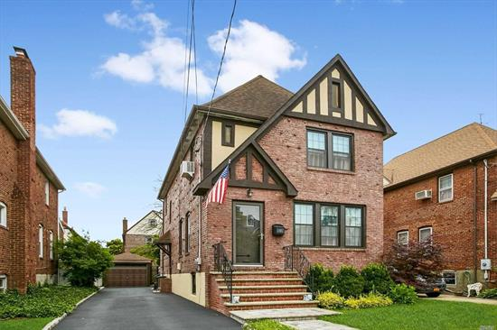 Impeccable 3 Bedroom Yorkshire Tudor Home, Eat in Kitchen with stainless steel appliances,  living room with fire place, formal dining room, den, updated baths, and so much more!