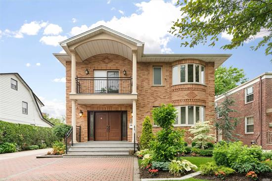 This modern luxury detached brick one family situated on a 6, 000 SF lot in the heart of Bayside.Built in 2013, Over 3, 200 SqFt interior space, this house features 4 bedrooms, 3.5 bathrooms, open kitchen, formal dining, high ceiling living room and 2-car detached garage. Top brand appliances in the kitchen. Two block to Northern Blvd, 3 minutes to Clearview Expy, close to great schools, transportation, restaurants, shopping and all. *All info deemed reliable but is NOT guara