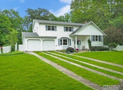Beautiful Setting with Super Private yard/ Nice Granite EIK w/ Gas Cooking/Bosch Appliances/Updated baths/ Wood Floors/Tile Floors/Andersen Windows/Roof 7 Yrs Yng/Smithtown West HS/Large Rear Yard with Picturesque Gardens/ Backs Protected Nature Preserve