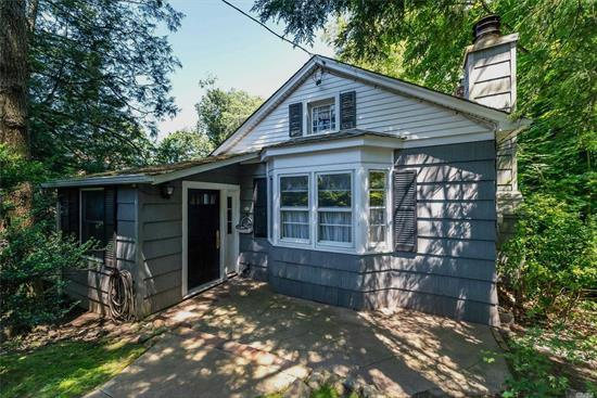 Have your Own Private Upstate Hideaway without leaving Long Island's Beautiful North Shore. 1/2 Wooded Acre. Great Bones. House Being Sold As Is. Cash Buyer Needed with Proof of Funds.Many Possibilities. Good Scale-Down or Add a Second Story. Full Attic Front to Back. Natural Gas in the House. Driveway in Rear of House Off Schoolhouse Lane. Glenwood Elementary