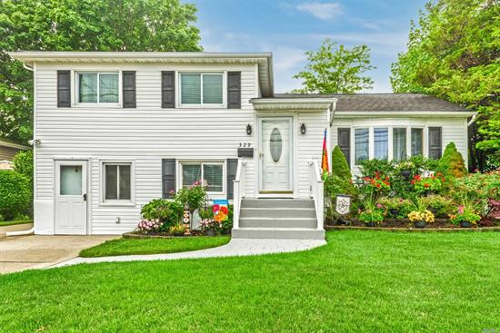 Beautifully maintained 3 bedroom split located in the much sought after Massapequa School District. Sliders open on to a Trex deck leading to a magnificently landscaped backyard. Close to schools, shopping, and transportation. Three-year young hot water heater, CAC, IG sprinkler system, 3 zone gas heat, crown molding throughout!