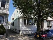 A Great Opportunity ! Large 2 Family House with 2 car garages in Maspeth. Near public transportation, shopping centers, schools and much more ..