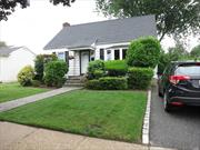 Beautiful expanded 4 br cape with many updates, FDR off kitchen, 2 year old Oil burner and hw heater,  5 year old roof, new bath, new kitchen with stainless steel appliances, granite countertops, gas stove, beautiful hardwood floors on main level. Full, finished basement, utilities.