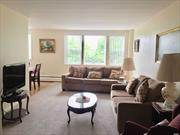 Great bright unit large entry foyer opens to spacious Lr, Dr,  kitchen w breakfast bar.King Bedroom, great closet space and lobby level private storage. Close to lirr and local shops. low maintenance $865 without Basic Star