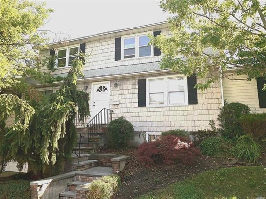 Second floor 2 bedroom apartment. LR/DR combo with EIK. Just Painted with new carpeting. Bright and sunny rooms. Attached garage and Laundry room on first floor Small Pets may be considered with add'l security. Convenient to town, LIRR, Schools and Beach. No Smoking...North Shore SD
