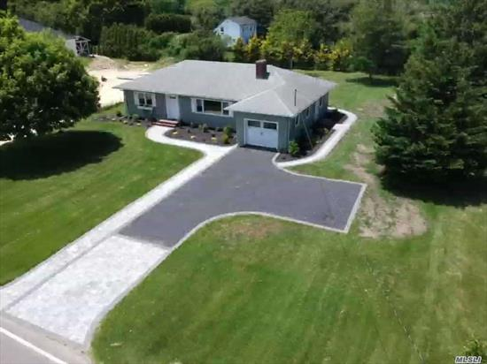 Sprawling Ranch In the Southampton town end of Eastport.Turn key Move in and enjoy the season.Custom paver patio, Walks and driveway .Custom Kitchen with Quartzite Tops all new stainless steel Appliances and designer glass backsplash.Baths with marble and subway style tile.Full basement with 8ft ceilings access from inside and outside of basement.3 large bedrooms Living room with builtins and wood burning Fireplace.Minutes from Beaches and Main St. West Hampton Village.Use of Dock and boat ramp.
