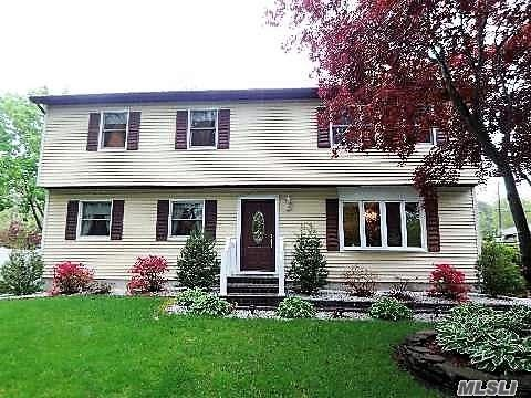 Outstanding 9 Rm, 4 Br, 2 Bath Colonial - Offers Huge Formal Dining Rm, Formal Living Rm, Eik W/Granite & Separate Breakfast Area + Updated Stainless Appl, Den/4th Br, King Size Mstr Br + 2 Other Large Brs. 5 Yr Old Efficient 3 Zone Heat Pump/CAC (14 Zone Electric Heating Sys As Backuo). Nightclub Finished Basement W/Separate Other Room. Amazing Landscaped Property W/Ponds, Waterfalls, Patio & Igs. Possible Mother/Daughter Or Large Family w/Proper Permits. This Beauty Won't Last!!!