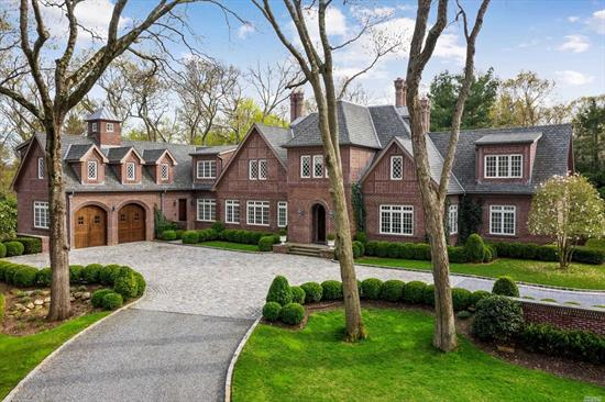 Absolutely stunning and unique 7500 sq ft stately brick tudor-style home on 2 lush, private acres with 1, 000 sq ft Studio Pool House w Fp, Kit, Bth and Radiant Heat. Saltwater Pool, Koi Pond, 5 bedrooms, 5 Full and 3 Half-Baths. Completed 9 years ago with no expense spared and attention to every detail. Separate Driveway accesses lower level of completely finished space with 11 foot ceilings and room to display 14 cars, Gym, Bonus Room, Br. Generator.Choice of Jericho or Syosset Schools.Cover of Dupont.