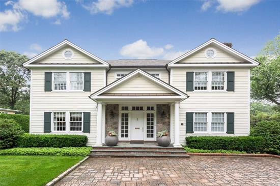 This 4000+Sf Center Hall Colonial Boasts Quality Craftsmanship W/A Spectacular Staircase Lr/Fp Fdr Gourmet Eik W/Granitetop, Top Of The Line Appliances, Wood Floors, 5Bdrms, 5 1/2 Bths. Master Suite W/Jacuzzi And Oversized Shower, Laundry Room On 2nd Fl Fin Lower Level Professionally Landscaped Property W/Belgium Block & Pavers, Impressive Columned Entry, 3 Car Garage W/Heat, 400 Amp Service, Igs, Radiant Heat, & Parking Privileges At Plandome