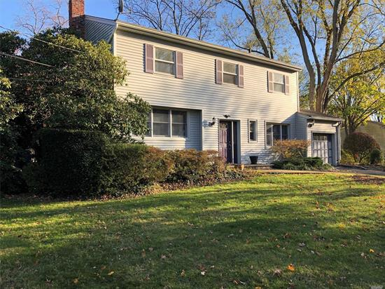 Charming Colonial in renowned Harborfields School District. Features attached Garage situated on 1/2 Acre of flat, fenced Property .Beautiful gardens surround a stone patio.First floor includes large Living Room, EIK w/ granite counters and Double ovens, Dining Room, Mudroom/Pantry and 1/2 Bath, beautiful hardwood and Tumbled Marble floors.. Second floor with 3 generous sized bedrooms , Sky-lighted Bath. Central Air, In Ground Sprinklers.Recent Septic System.Move right into this Fine Country Home.