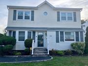 Beautiful Colonial located in prime section of Hicksville. Close to LIRR, Parkways and shopping centers. Move-in ready. Backyard with electric awning. Long driveway leading to 1 car garage. 3 zone heat, CAC, built-in dehumidifier in finished basement, full bath, playroom, plenty of storage and OSE!