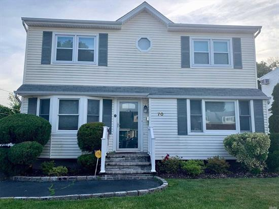 Beautiful Colonial located in prime section of Hicksville. Close to LIRR, Parkways and shopping centers. Woodland School. Move-in ready. Backyard with electric awning. Long driveway leading to 1 car garage. 2 zone heat, CAC, built-in dehumidifier in basement with plenty of storage and just waiting to be finished. Motivated Seller!