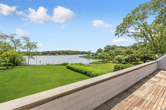 Welcome to this impeccably maintained Post Modern home. With over 3800 sq.ft. of living space and 92' water front w/dock & direct bay access. Contained within are 4 BRs, 4.5 baths including 2 master suites, office, EIK, den w/fireplace & wet bar. Formal LR, Formal DR, three season water view sun room. Expansive upper & lower water view decks. Finished basement, 2 car garage. Professionally landscaped grounds w/mature plantings. Minutes to Bay beach. Permits in place for in ground pool.
